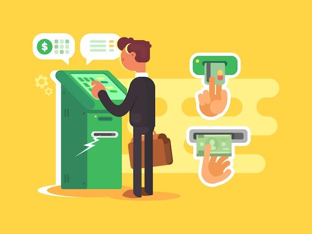 Mann nimmt bargeld vom geldautomaten
