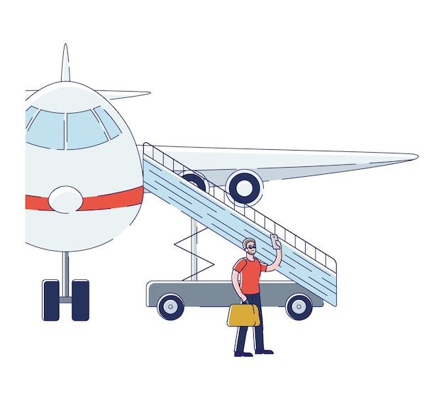 Mann passagier, der selfie beim einsteigen in flugzeug nimmt
