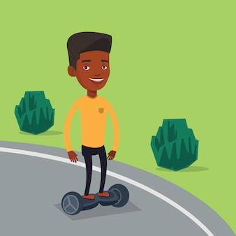 Mann reitet auf selbstausgleichendem elektroroller.