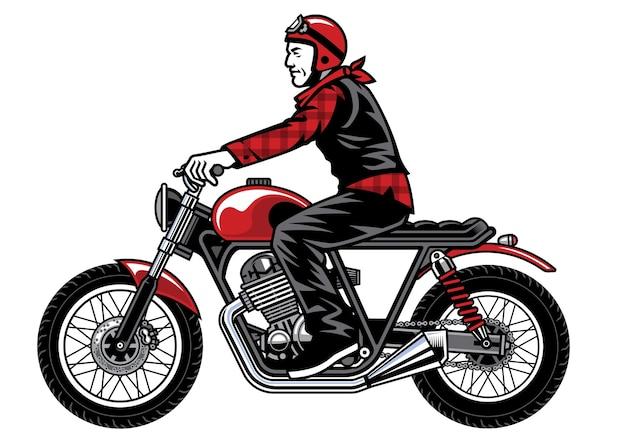 Mann reitet vintage benutzerdefiniertes motorrad