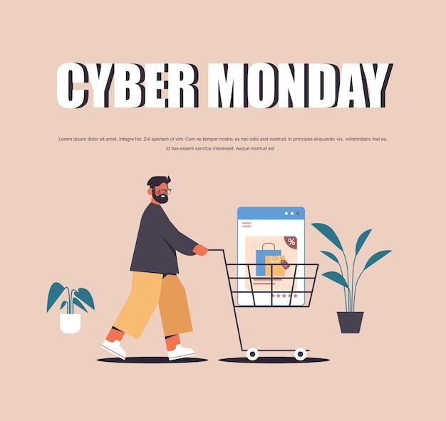Mann schiebt webbrowser-fenster in trolley cart online-shopping cyber montag verkauf urlaub rabatte e-commerce-konzept kopie platz