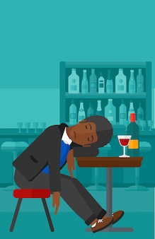 Mann schläft in der bar