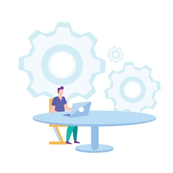 Mann sitzen auf stuhl bei tisch, der an laptop arbeitet.