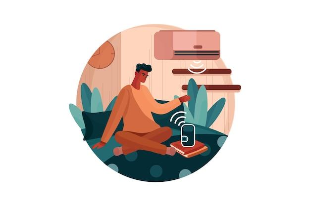 Mann sitzt auf dem bett unter verwendung der klimaanlage und taktgesteuert durch lautsprecherstimme