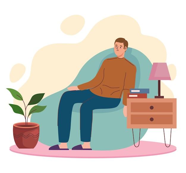 Mann sitzt auf der couch