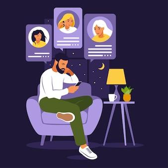 Mann sitzt auf sofa mit telefon