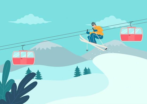 Mann skifahren am schneebedeckten berg