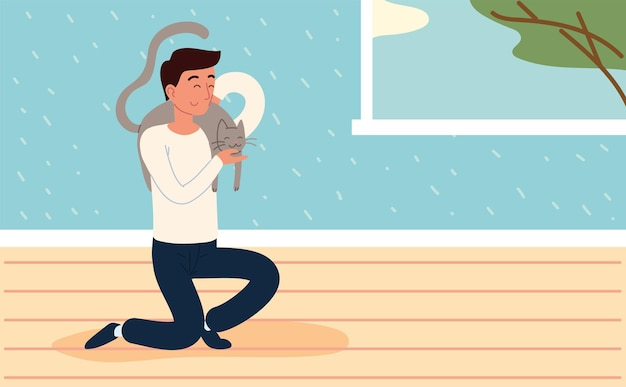 Mann spielt mit katze