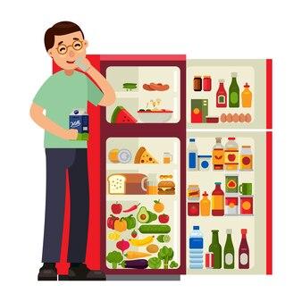 Mann trinkt mit kühlschrank