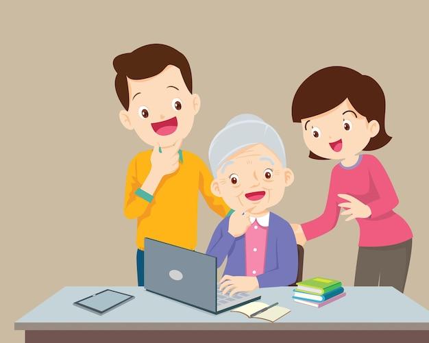 Mann und frau betrachten ältere frau unter verwendung eines laptop-computers