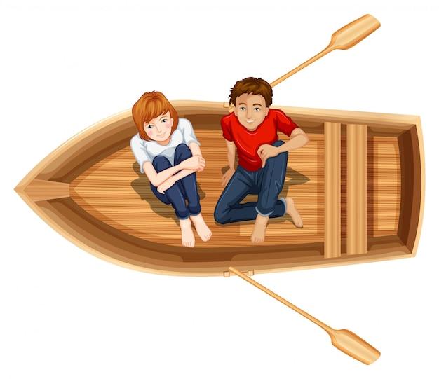 Mann und frau sitzen auf dem boot