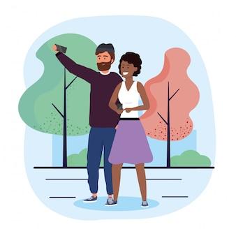 Mann- und frauenpaare mit smartphone und bäumen