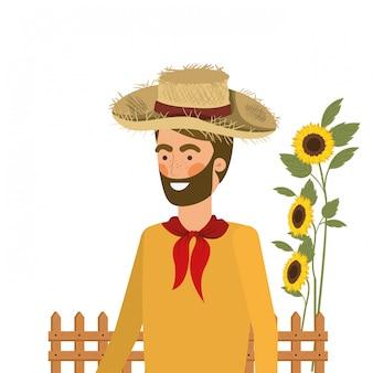 Mannbauer mit strohhut und sonnenblumen