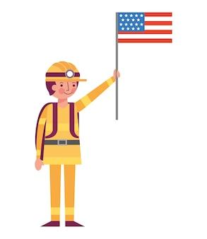 Mannbergmann im sturzhelm, der amerikanische flagge hält