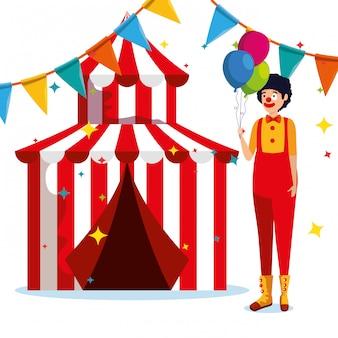 Mannclownkostüm und -zirkus mit parteifahne