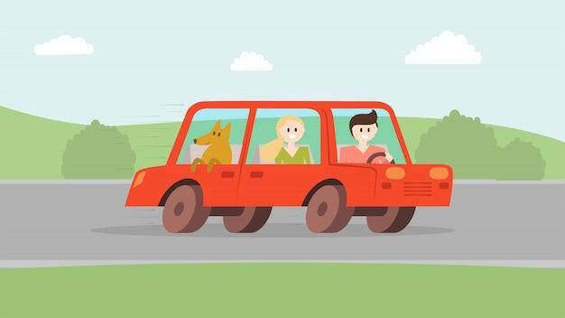 Mannfrau mit dem hund, der mit dem auto geht
