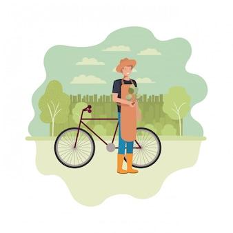 Manngärtner mit landschaft und fahrrad