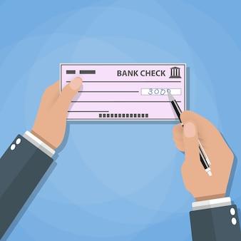 Mannhände mit stiftschreibscheck. bankzahlungen