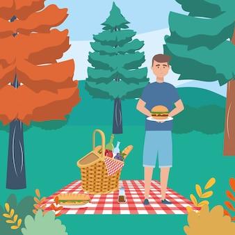 Mannkarikatur, die picknick hat