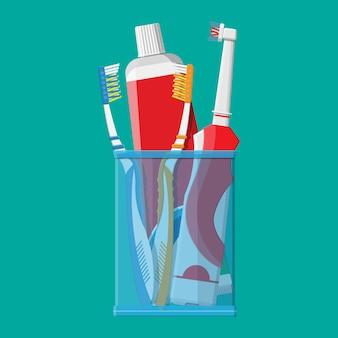 Manuelle und elektrische zahnbürste, zahnpasta, glas