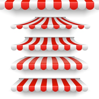 Markisen im freien. sonnenschirme der roten und weißen streifen auf weißem hintergrund