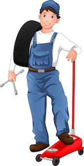 Mechaniker posiert mit reifen