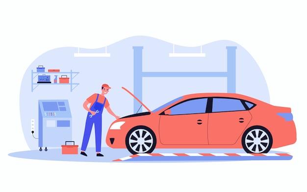 Mechaniker repariert auto in garage