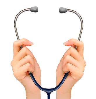 Medizinischer hintergrund mit händen, die ein stethoskop halten.