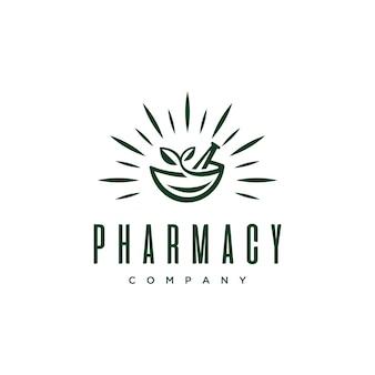 Medizinisches logo der weinlese-apotheke mit natürlicher mörser- und stampferdesign-vektorschablone