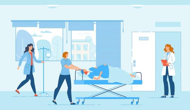 Medizinisches personal und schwangere frau auf beweglichem bett