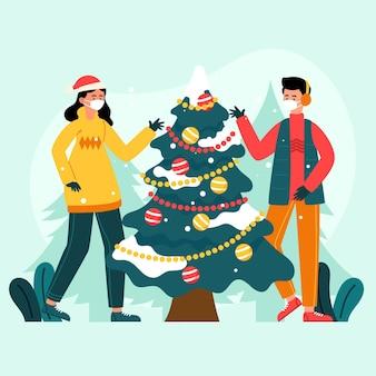 Menschen, die weihnachtsbaum verzieren, während sie medizinische masken tragen