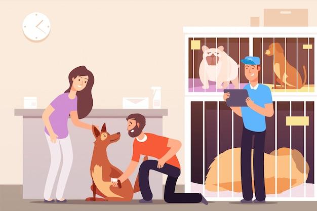 Menschen im tierheim mit katzen und hunden in käfigen