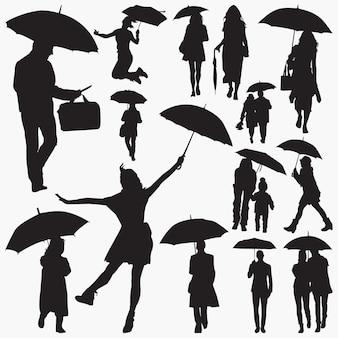 Menschen mit regenschirm-silhouetten