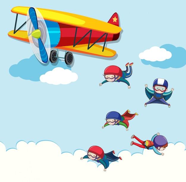 Menschen springen aus einem flugzeug