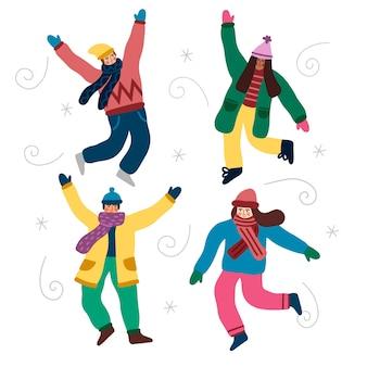 Menschen tragen winterkleidung springen