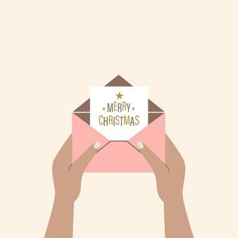 Menschliche hände halten einen offenen umschlag mit einem gruß der frohen weihnachten moderne vektorillustration