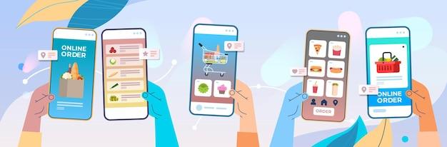 Menschliche hände unter verwendung der mobilen app für die bestellung von lebensmitteln schnelle lieferung online-shopping e-commerce lebensmittelbestellkonzept horizontale vektor-illustration