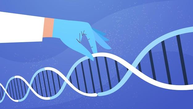 Menschliche hand, die genetische dna-helix-molekülstruktur-klinik zur medizinischen behandlungforschung und -prüfung hält