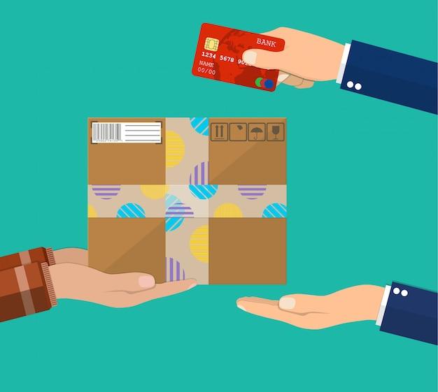 Menschliche hand hält geld und zahlt für das paket