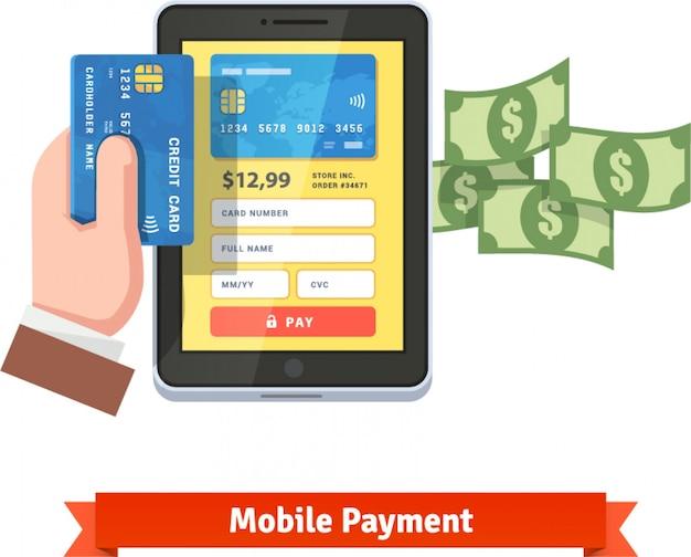 Menschliche hand hält kreditkarte über tablette
