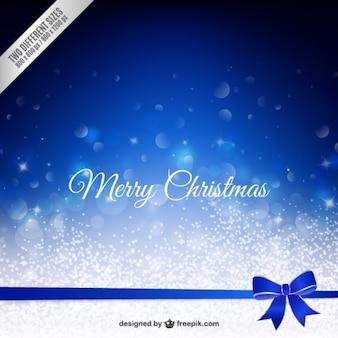 Merry christmas bokeh hintergrund mit einem blauen bogen