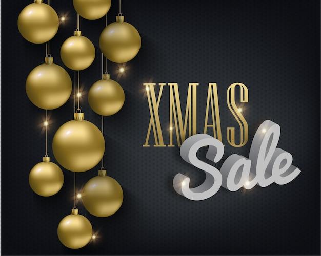 Metallische goldene weihnachtskugeln auf einem schwarzen hintergrund