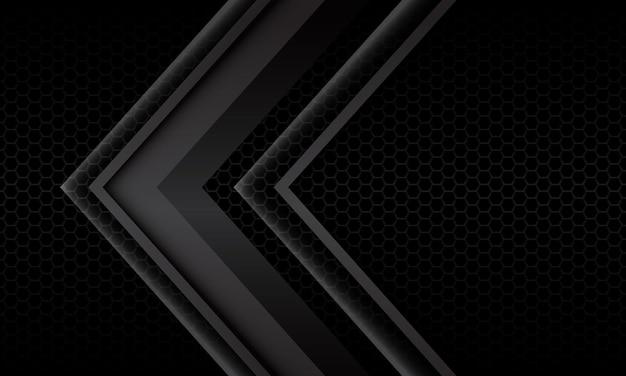 Metallische richtung des abstrakten grauen pfeilschattens geometrisch auf dem modernen futuristischen hintergrund des schwarzen sechsecknetzes