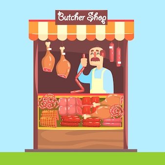 Metzger hinter marktzähler mit fleischsortiment