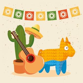 Mexikanische kaktushutgitarre und pinata