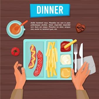 Mittagessen draufsicht. schulspeisetablett auf dem tisch sortieren produkte mahlzeiten früchte snacks und getränke schuljunge, der hände bilder des mittagessens isst.