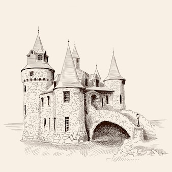 Mittelalterliches steinschloss mit türmen am meer und einer brücke.