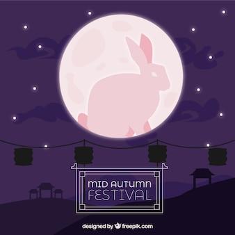 Mittleres herbstfest, szene mit rosa mond und kaninchen