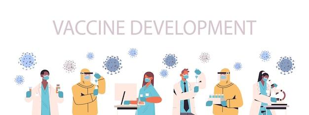 Mix race wissenschaftler, die impfstoffe entwickeln, um gegen das coronavirus-forscherteam zu kämpfen, das in der horizontalen darstellung des impfstoffentwicklungskonzepts für medizinische labors arbeitet