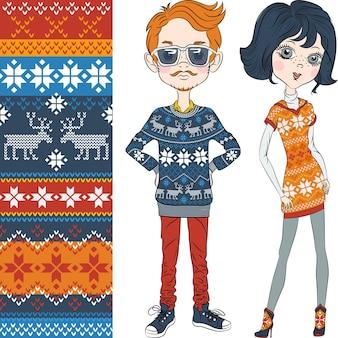 Mode hipster junge und mädchen in gestrickten pullovern mit norwegischen nahtlosen muster